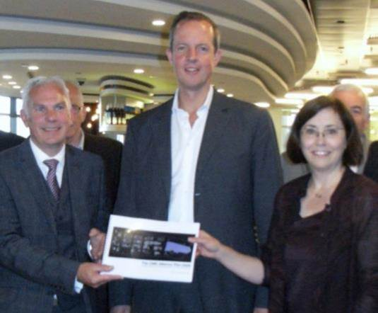 Planning Minister Nick Boles (centre) receives a copy of the new CMK Alliance Plan from Dr Rebecca Kurth (right), Mr Paul Hunt (left) and other civic figures. (Photo courtesy Linda Inoki)
